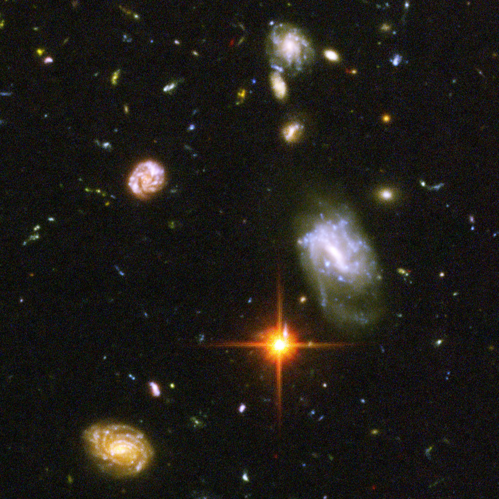 A scene from the Hubble Ultra Deep Field. We can look back at some of the earliest galaxies to emerge in an ancient universe.