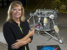 NASA engineer Julie Bassler and the robotic lander prototype undergoing testing at Marshall.