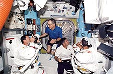 Astronauts prepare for a spacewalk.