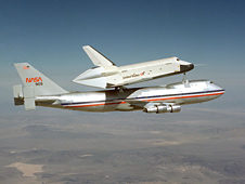 Space shuttle prototype Enterprise rides atop NASA's Shuttle Carrier Aircraft .