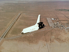 Space shuttle prototype Enterprise dives toward the runway on Rogers Dry Lake at Edwards Air Force Base.