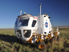 The Space Exploration Vehicle is tested as part of Mission Day 2 operations during the 2010 Desert RATS field tests at Black Point Lava Flow, Arizona. Photo credit: NASA