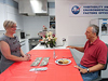JSC2011-E-060786: Astronaut Mike Massimino samples food