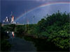 A rainbow near a shuttle on the launchpad