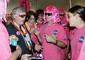 Participants in the FIRST robotics competition speak to KSC Director Jim Kennedy.