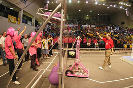 Participants in the FIRST robotics competition cheer on their entry.