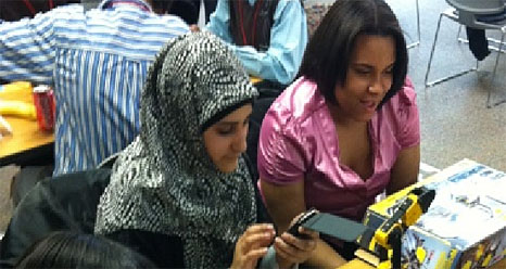 Students building and programming robots