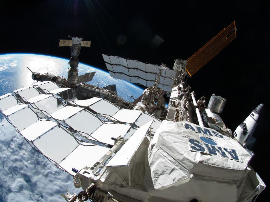 Astronaut Ron Garan took this image during the spacewalk conducted on Tues., July 12, 2011. It shows the International Space Station with Space Shuttle Atlantis docked on the right and a Russian Progress resupply ship on the far left. In the foreground is the Alpha Magnetic Spectrometer (AMS) experiment installed during the STS-134 mission. AMS is a state-of-the-art particle physics detector designed to use the unique environment of space to advance knowledge of the universe and lead to the understanding of the universe's origin by searching for antimatter and dark matter, and measuring cosmic rays.
