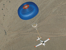 Cirrus SR20's parachute deploys, arresting the plane's descent.