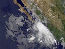 Infrared image from GOES-11  on July 19 shows Tropical Storm Dora's clouds are reaching western coastal Mexico.