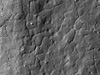 Polygonal fractures on a flow lobe of impact melt splashed out of Tycho crater.
