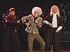 Actors dressed like Galileo, Isaac Newton and Einstein
