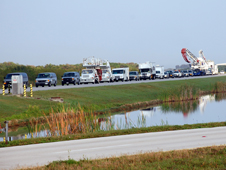Shuttle convoy vehicles begin to snake their way toward Kennedy Space Center's Shuttle Landing Facility