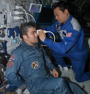 Using the ADUM protocols, ISS Expedition Commander Leroy Chiao performs an ultrasound examination of the eye