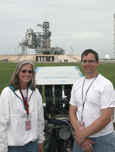 Louise Walker and JT Heineck by their camera area at KSC launch pad