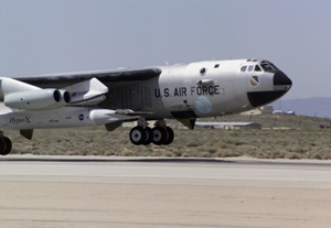 NASA's B-52B launch aircraft takes off carrying the second X-43A hypersonic research vehicle on March 27, 2004. NASA photo by Tom Tschida.