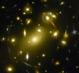 Astronomers use the light-bending properties of gravity to view very distant galaxies--such as the arc shapes in this image--in a technique called gravitational lensing.