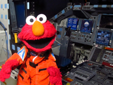 Sesame Street's Elmo on the flight deck of a space shuttle