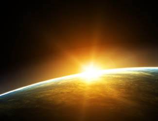 Image of a sunrise over Earth from space.