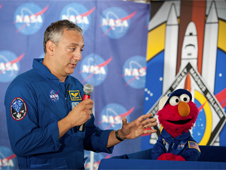 Mike Massimino and Sesame Street's Elmo at NASA's Kennedy Space Center