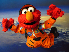 Sesame Street's Elmo in orange flight suit