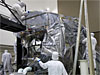 Technicians remove the protective wrapping from NASA's Juno spacecraft