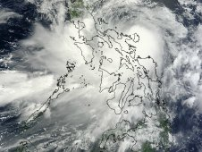 MODIS captured Nock-ten on July 26, 2011 at 02:30 UTC as its center was moving over the Philippines.