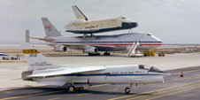 NASA's modified F-8C Digital Fly-By-Wire research aircraft was photographed on the ramp in front of the prototype space shuttle Enterprise mated to its modified Boeing 747 Shuttle Carrier Aircraft in 1978.