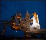 Image of Shuttle on the stand at night.