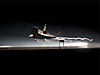 Space shuttle landing at night