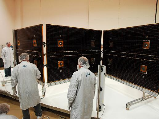 Technicians test NPP solar array deployment