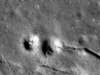 A wrinkle ridge cross-cuts and deforms an impact crater in northeast Mare Imbrium