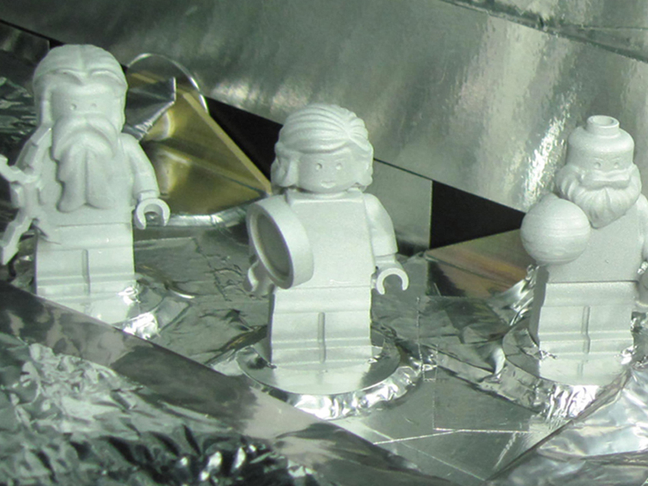 Three LEGO figurines representing the Roman god Jupiter, his wife Juno and Galileo Galilei are shown here aboard the Juno spacecraft.