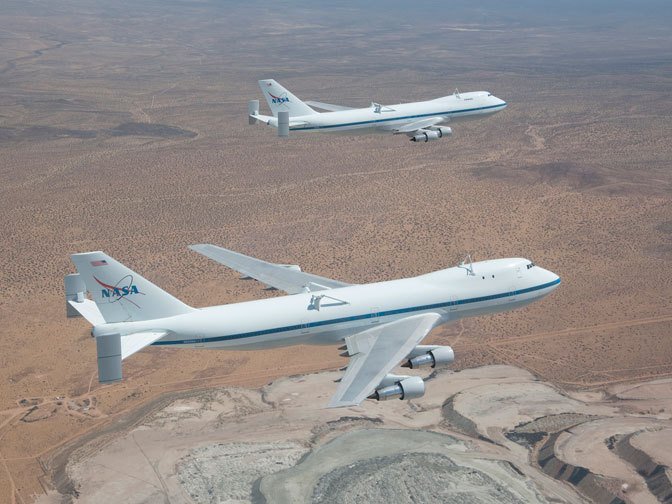 NASA's Shuttle Carrier Aircraft 905 (front) and 911 (rear) were captured by photographer Carla Thomas as they flew in formation over the Rio Tinto Borax Mine west of Boron, Calif.