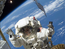 Mission Specialist Steve Bowen performs a spacewalk
