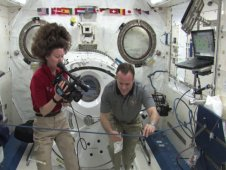 Astronauts Cady Coleman and Ron Garan perform the Attracting Water Drops experiment from Chabad Hebrew Academy in San Diego, CA.