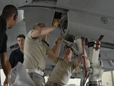 "Airmen of the 23rd Equipment Maintenance Squadron make preparations to inspect for cracks within the wing frame of an A-10C Thunderbolt II, or ""Warthog,"" model. The risk of structural damage to wings of A-10 models was discovered at Hill Air Force Base, Utah."