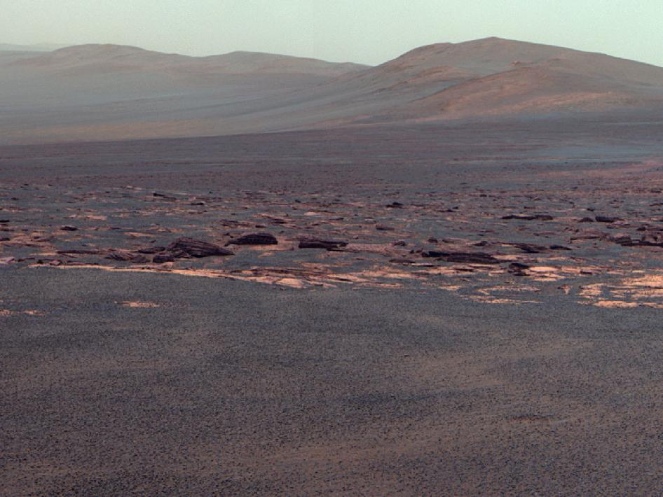 A portion of the west rim of Endeavour crater sweeps southward in this color view from NASA's Mars Exploration Rover Opportunity