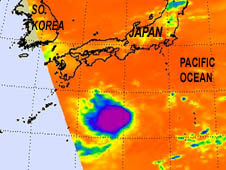 Cold cloud tops of the thunderstorms in Tropical Depression 13W in the open waters of the western North Pacific Ocean.