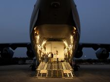 NASA's two GRAIL spacecraft wait to be offloaded from an Air Force C-17 cargo plane
