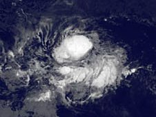 GOES-11 image from August 15 at 0600 UTC shows Tropical Depression 6E as a small rounded area of clouds.