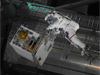 Spacewalker Mike Fossum carries the Robotic Refueling Mission module from shuttle Atlantis to its temporary platform on the International Space Station on July 12, 2011.