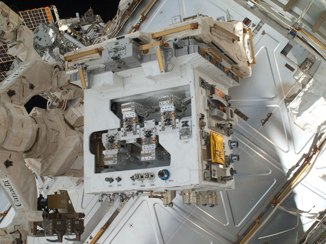 The Robotic Refueling Mission module, installed on its temporary platform on the International Space Station's Dextre robot.  RRM will demonstrate robotic servicing technology and lay the foundation for future missions.