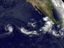 On August 17 at 1200 UTC (8a.m. EDT), GOES-11 caught Fernanda (left) and Greg (right).
