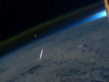 A Perseid meteor lights up as it streaks through the Earth's atmosphere, as seen and photographed by Ron Garan while aboard the ISS on August 13, 2011