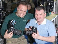 NASA astronaut Ron Garan (left) and Russian cosmonaut Alexander Samokutyaev, both Expedition 27 flight engineers, pictured while holding still cameras in the Zvezda Service Module