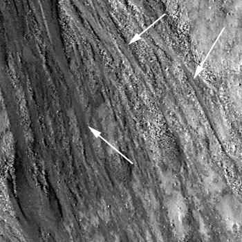 Arrows point to incisions cut into the crater wall by the flows