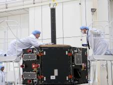 Engineers at JHUAPL inspect Radiation Belt Storm Probe A in the clean room.