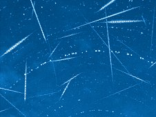 Composite of 49 Perseid meteors, seen during the 2011 shower.  The concentric circles are star trails.