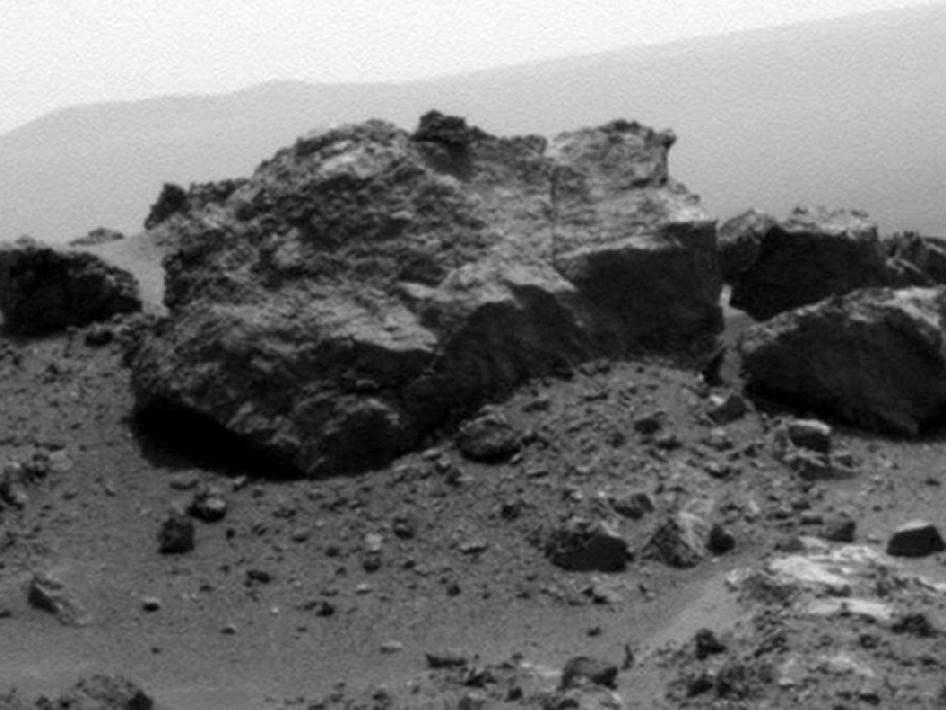 Rock on rim of Odyssey crater